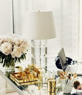 vignette styling coffee table gold accessories acrylic lamp