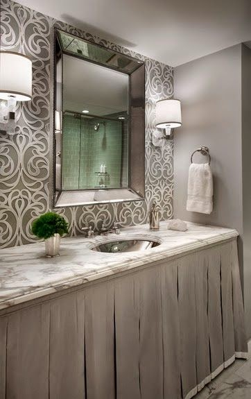 bathroom with skirted vanity and intricate wallpaper