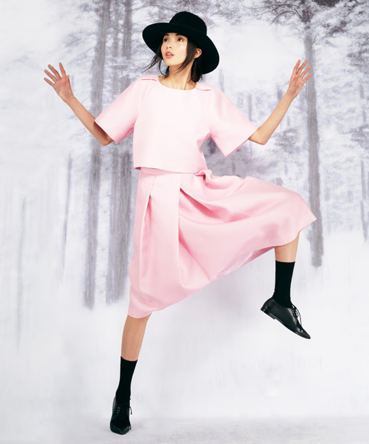 Xiao Wen Ju for the Tibi fall 2014 look book, all baby pink look, pleated midi skirt, boxy t-shirt, black pointy toe brogues