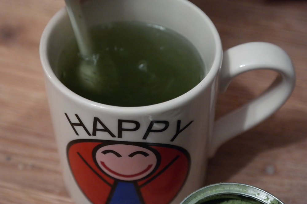 "Stirring teapigs Matcha into ""Happy"" mug"