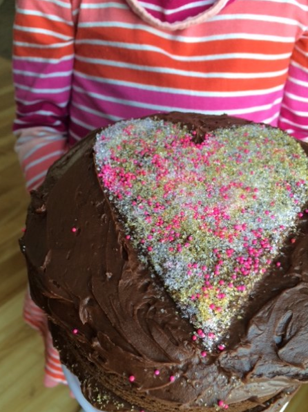 Even kids can help dress up a cake for Valentine's Day. | DIY Sprinkle Heart Cake Topper | Sweet Tooth