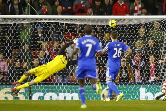 Chelsea goalkeeper Petr Čech is unable to save a goal from Stoke player Oussama Assaidi