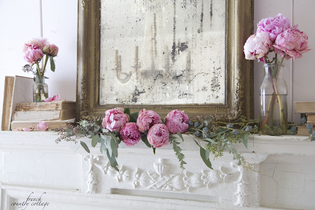 Antique mantel with flowers
