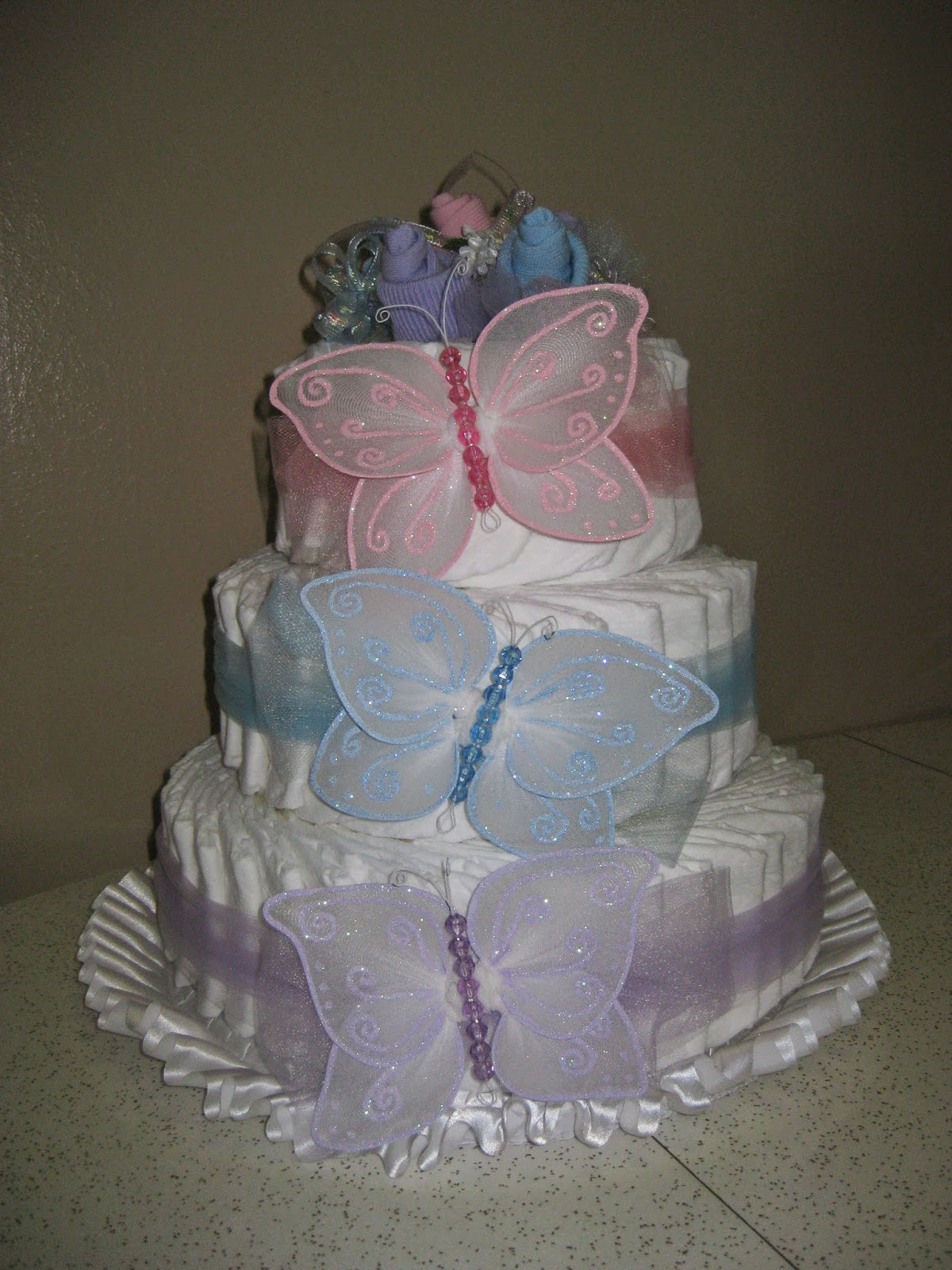 For My Own Baby Shower, We Used A Pastel Butterflies Theme And I Made This  Butterfly Diaper Cake! I Used Over 100 Size 1 Diapers, Tulle, Baby Socks,  ...