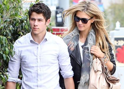 Nick Jonas and girlfriend Delta Goodrem hand-in-hand