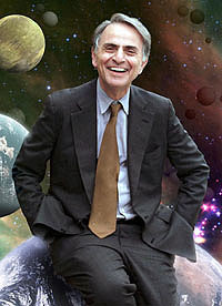 Carl Sagan leaning against the earth and smiling