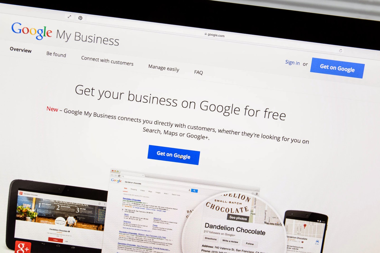 A photo of a laptop screen showing the Google My Business home website