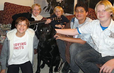 A village of Foster Care Providers with a black Lab