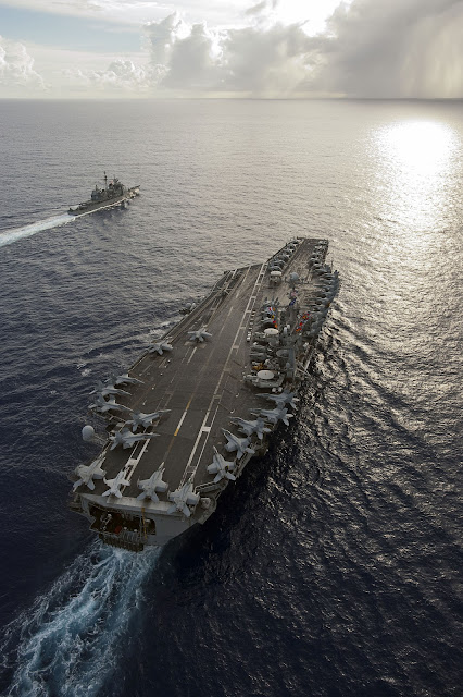USS George Washington (CVN 73) and the Ticonderoga-class guided-missile cruiser USS Mobile Bay (CG 53) are underway in the Pacific Ocean