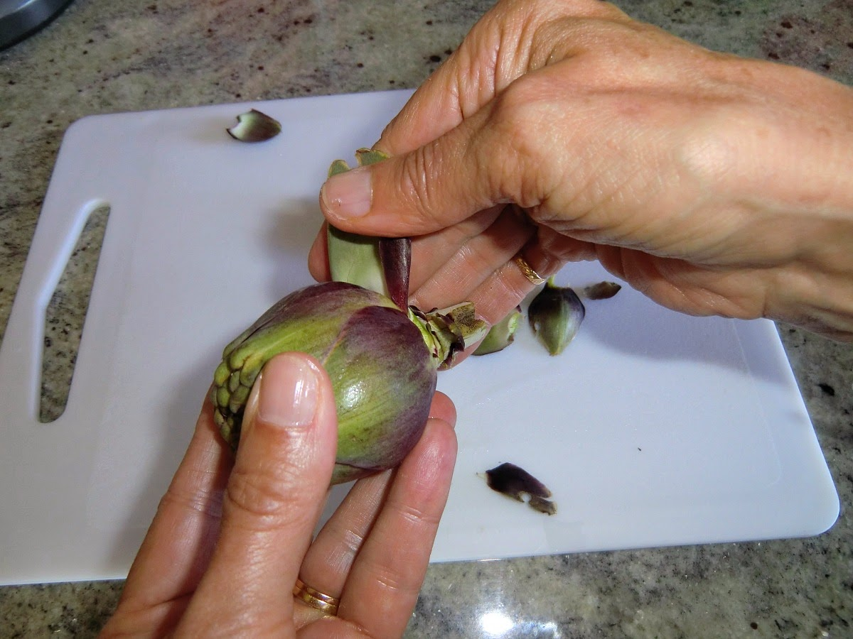 Pull off and discard the tough outer leaves of the artichoke
