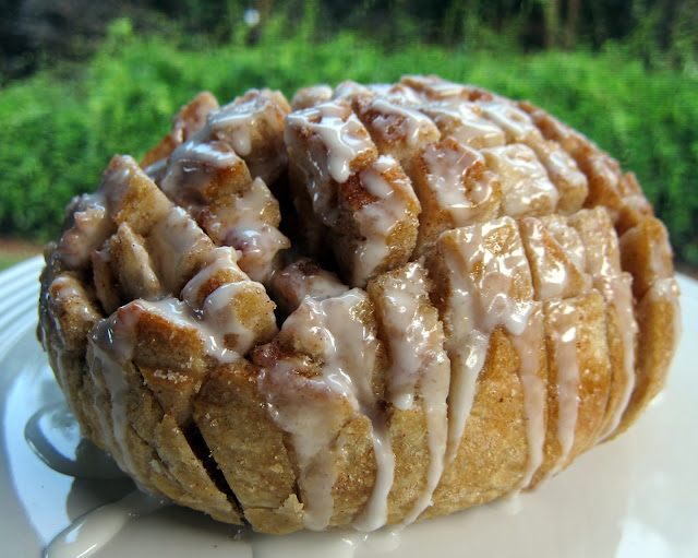 Cinnamon Roll Pulls Recipe - sourdough loaf cut across both ways, slathered with an amazing Vanilla Honey Butter, sprinkled with cinnamon and sugar, baked and drizzled with a powdered sugar glaze. SOOOO good! Took this to a party and it was gone in a flash! Everyone loved it. Great for breakfast too. Can make ahead of time and put in fridge for an easy weekday breakfast.