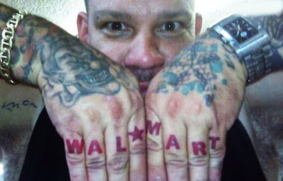 Guy with Wal-Mart knuckle tattoos