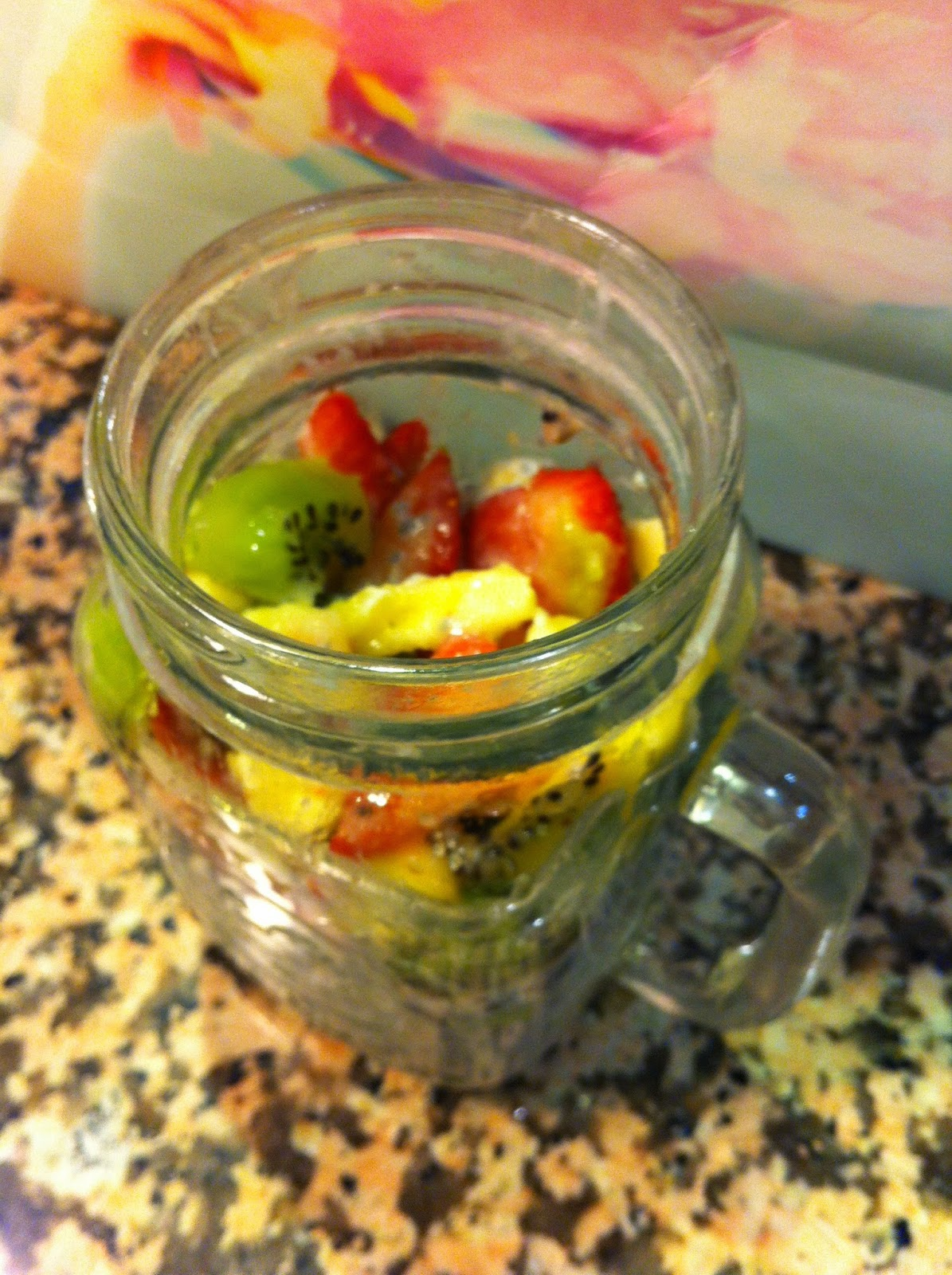 Refrigerator Oatmeal, Breakfast with Kiwi Banana Strawberries Raspberries and Chia in a Mason Jar