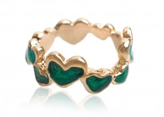 small green hearts with a gold edge form an uneven ring