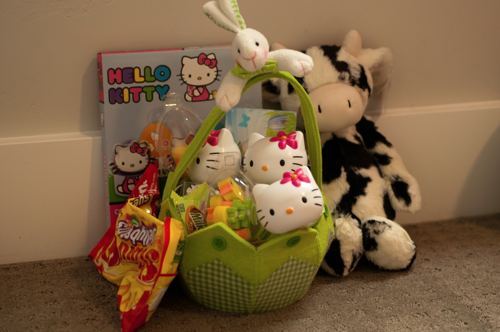 easter, girl easter basket, hello kitty, hello kitty easter egg, cow, jelly cat, jellycat, jellycat cow, easter egg dye, fabric basket, starburst jelly beans, snickers, easter egg snickers