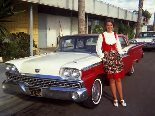 Her new Ford matches her waitress uniform. 1959