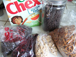 snack mix ingredients:  Chex, dark chocolate chips, pretzel twists, raisins, dried cranberries, peanuts