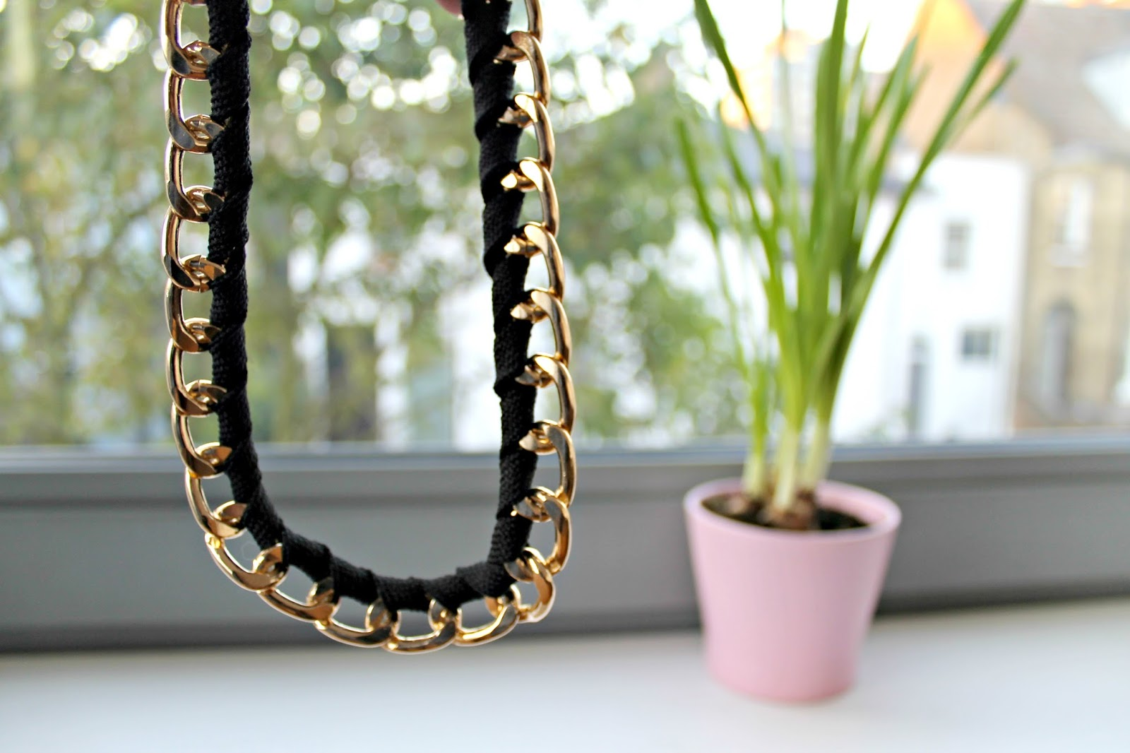 detail of black and gold necklace
