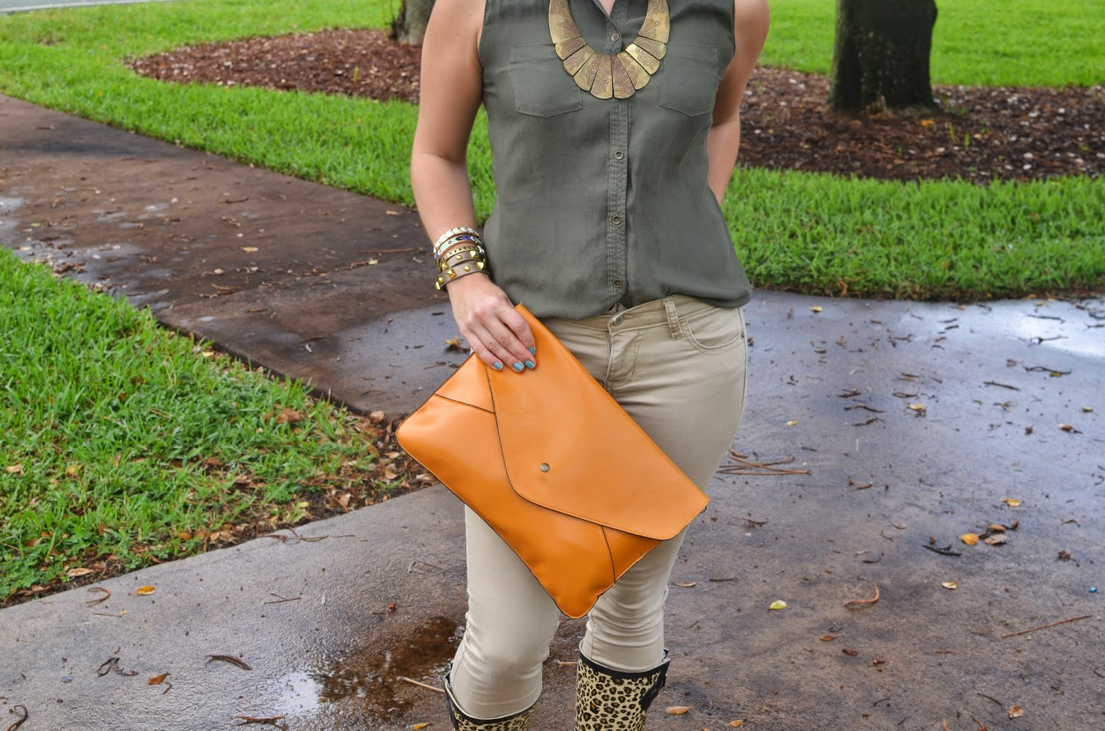 Cream pants - green top - envelope clutch - rain boots - statement necklace