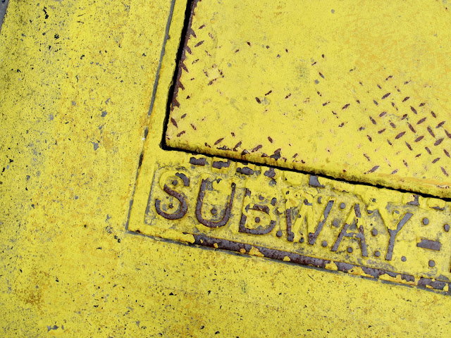 yellow subway grate