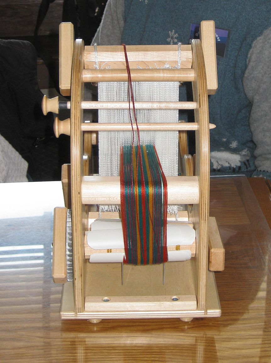 Debbie had a very interesting loom it s an alternative to the traditional inkle loom i can t remember what it s called it has texsolv heddles and a
