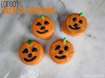 overhead shot of orange jack o lantern decorated oreos with words
