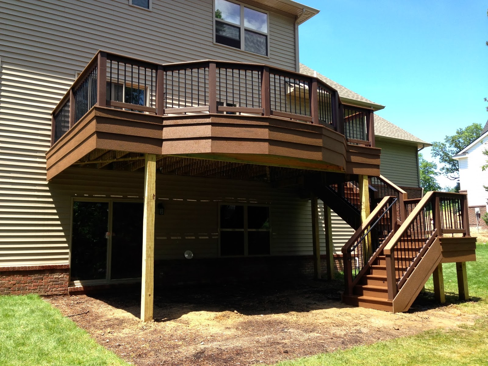 Outdoor living deck designs from 2013 adding flair to a Walkout basement deck designs
