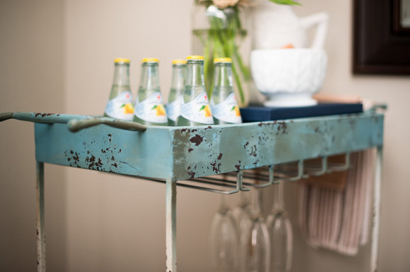 This creative distressed bar cart adds an antique element to the room.