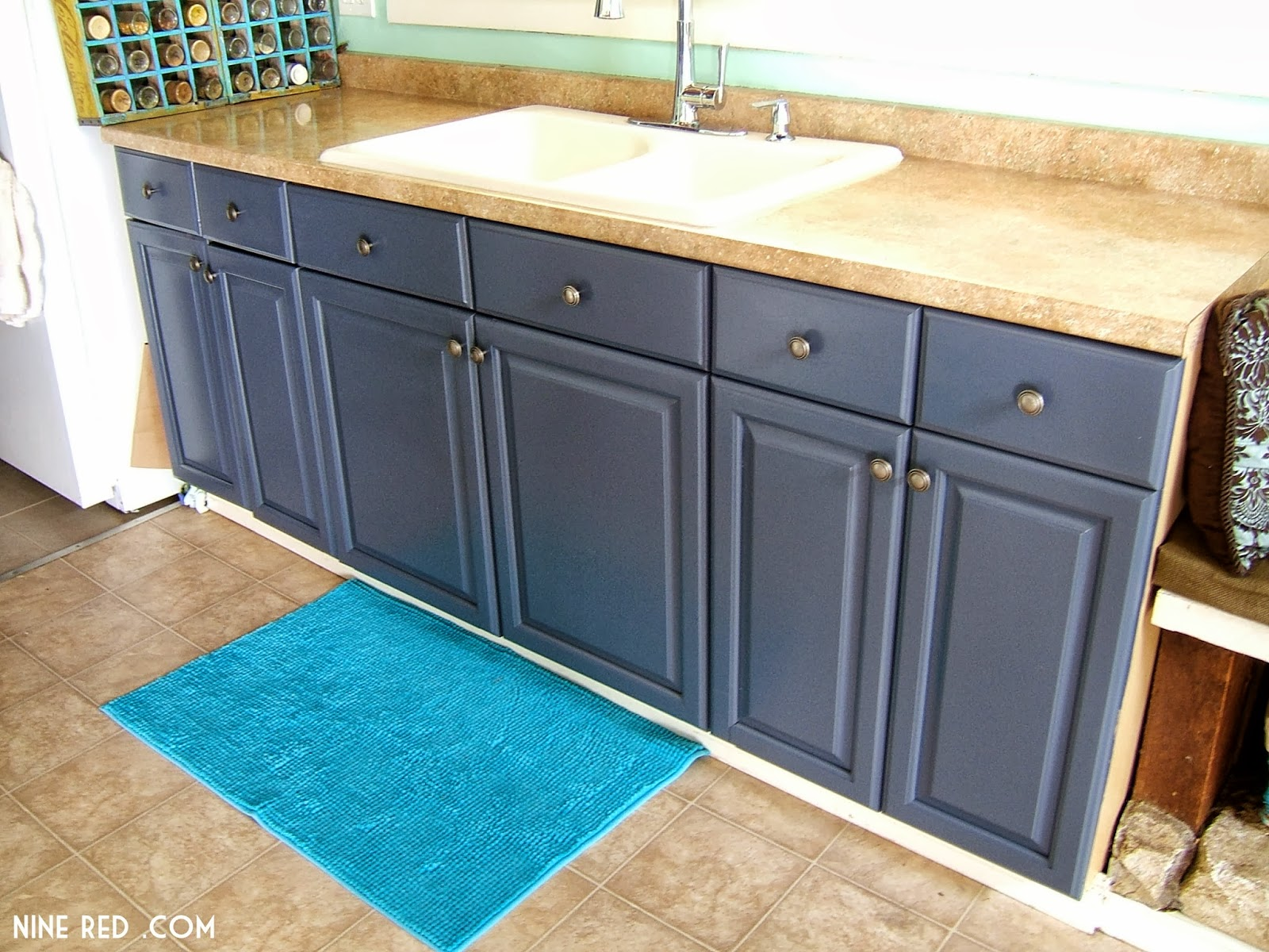 White kitchen cabinets light blue walls for Dark blue kitchen cabinets
