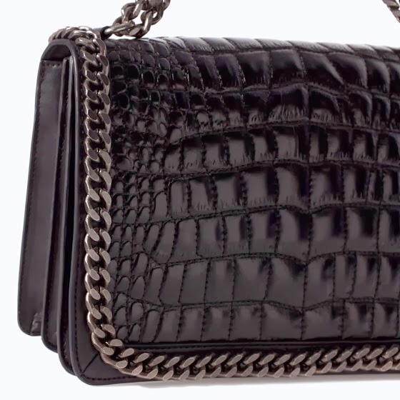 7f44caaffcdc Plus just like the Boy Chanel, the strap can also be worn long or doubled  up depending on how you want to wear it! The interior also boasts two main  pockets ...