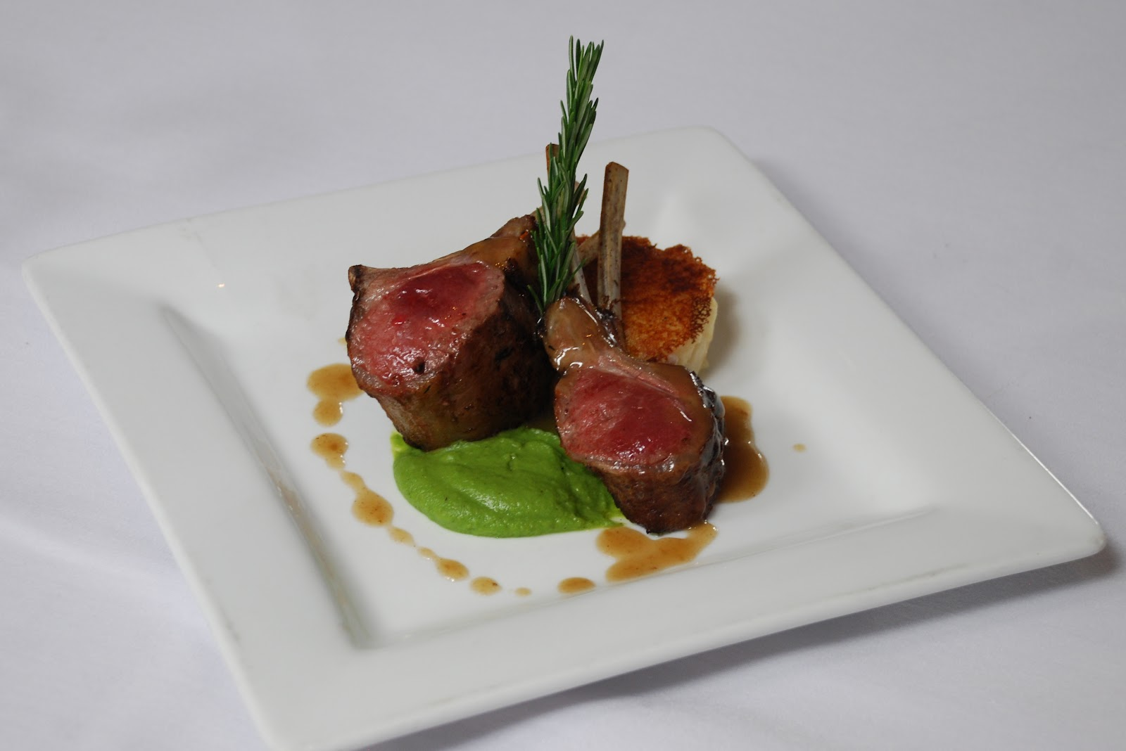 Roasted New Zealand Rack of Lamb with Lyonnaise Potato Cake, Bacon ...