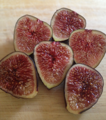 Image of sliced figs. They're fresh and juicy at the peak of the season