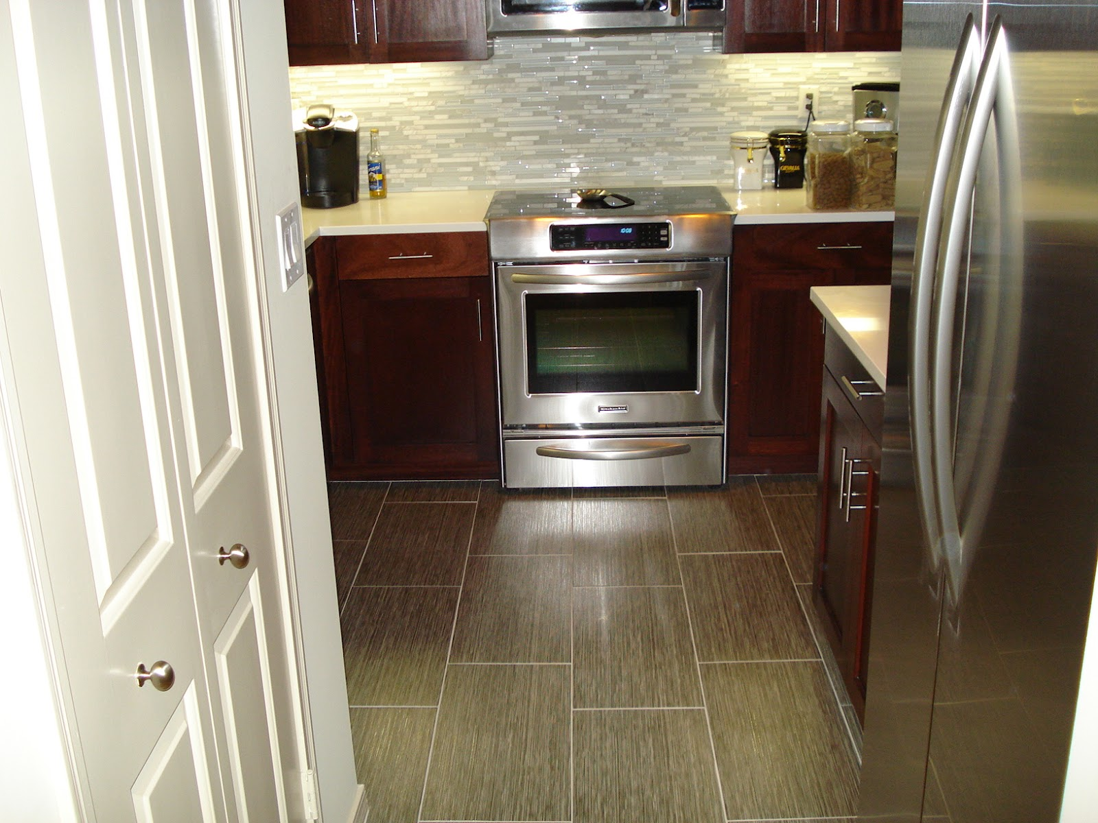 Replacing broken porcelain floor tile confessions of a tile setter this is a textured tile with a deep brown color and is cleverly accented in an oyster gray grout this contrast makes for a very attractive floor dailygadgetfo Choice Image