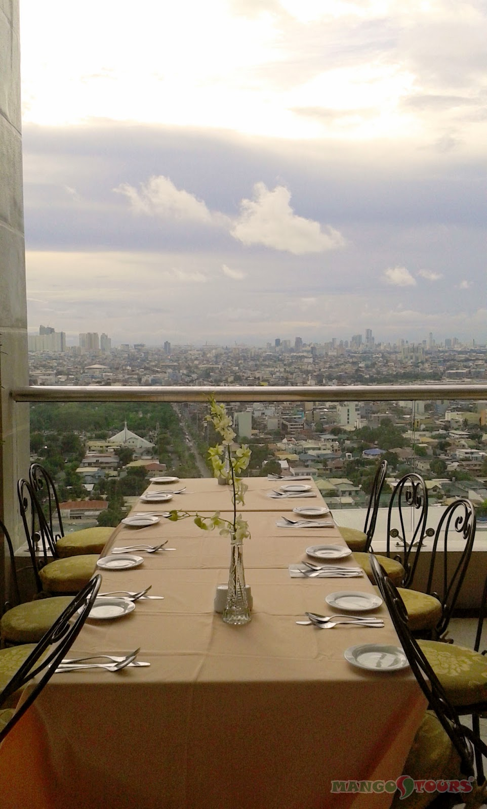 City Garden Hotel Makati roof deck dining cityscape