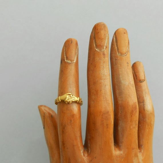 https://www.etsy.com/listing/162634732/antique-fede-gimmel-ring-18k-gold-hands?ref=shop_home_active_5
