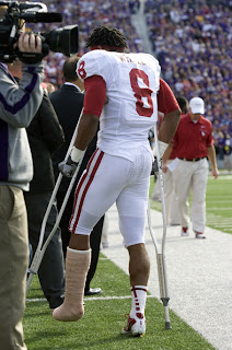 Dominique Whaley #8 of the Oklahoma Sooners walks along the sideline on crutches after being injured in the first quarter during a game against the Kansas State Wildcats at Bill Snyder Family Stadium on October 29, 2011 in Manhattan, Kansas. (October 28, 2011 - Source: Ed Zurga/Getty Images North America
