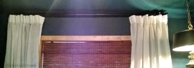 White Ikea Vivan hung with rings cordless bamboo roman shade Benjamin Moore Dark Teal wall color