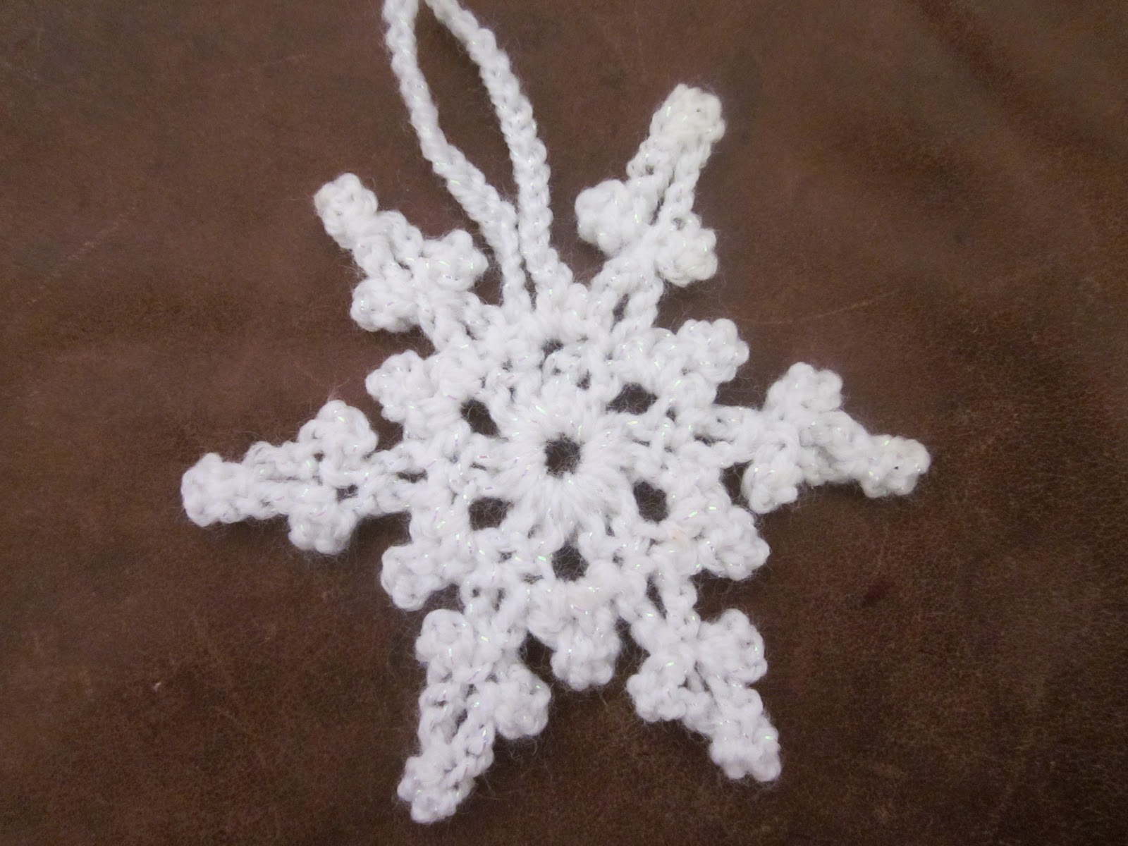 Pretty and very quick to make snowflake decoration just two rounds