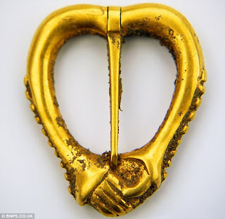 metal detector, gold brooch,