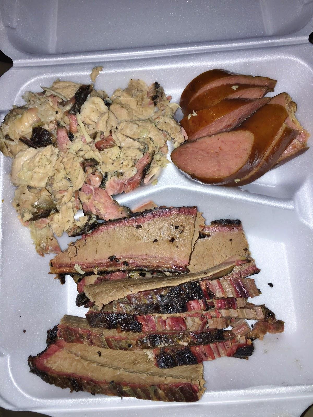 A trio of meats from Lander's: Brisket, Pulled Pork, Sliced Sausage