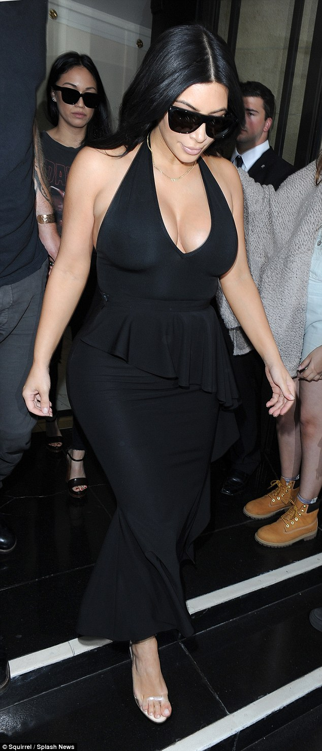 Kim Kardashian flaunts ample cleavage in a black dress in London