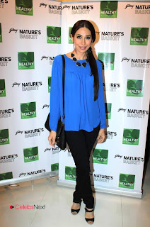 Karishma Kapoor Latest Pictures in Skinny Jeans at Godrej Nature Basket Launch  0005