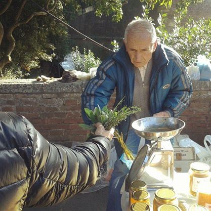 A Tuscan vendor of locally grown produce at the Siena market