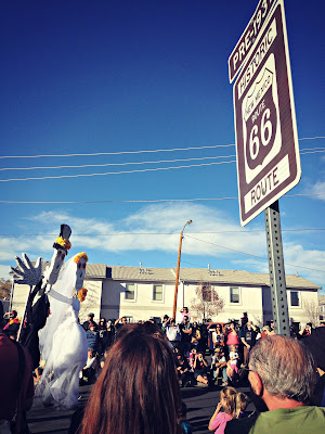Bride and groom skeleton float passes through Route 66 in the South Valley of Albuquerque, New Mexico during a Dia de los Muertos celebration.