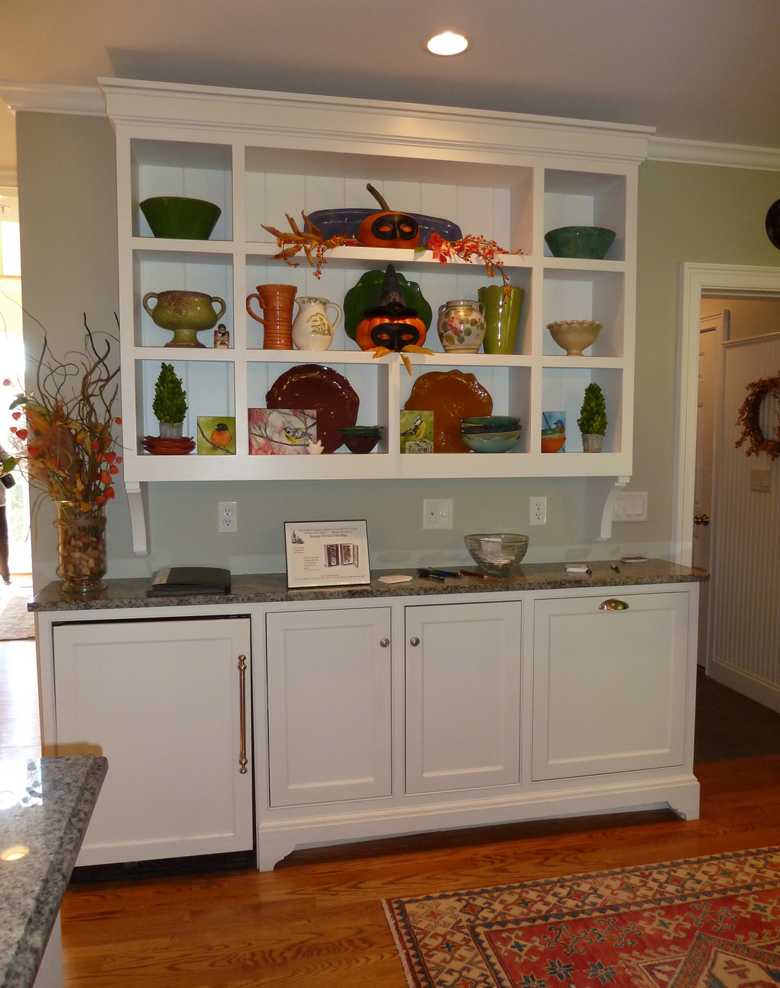 wine fridge built into a separate set of wall cabinets is out of the