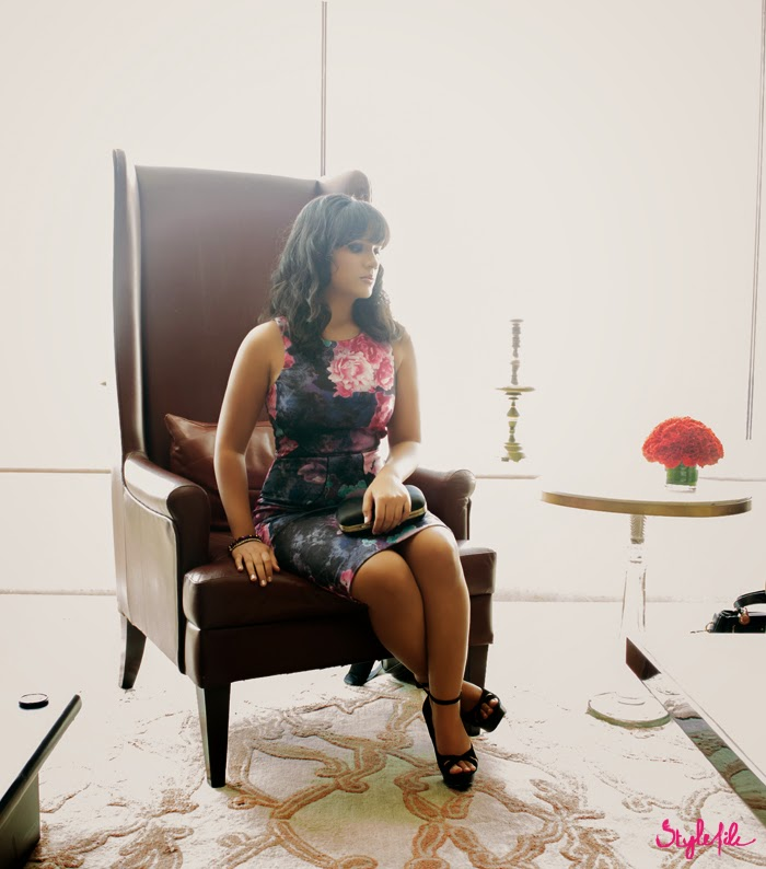 Dayle Pereira of Style File India wears a Miss Selfridge bodycon dress via Jabong with Zara stilettos, beachy waves and a minaudiere on a leather seat against the sunlight