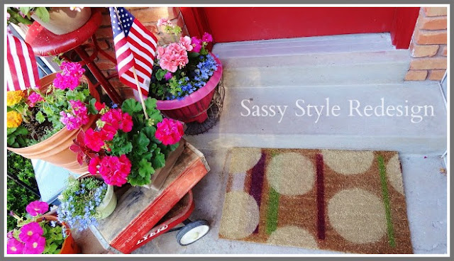 http://www.sassystyleredesign.com/2011/07/just-sweep-it-under-spray-painted-rug.html