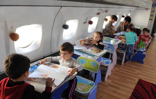 SEBAHAGIAN kanak-kanak yang belajar di dalam pesawat Yakovlev Yak-42.