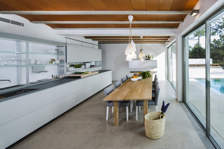 Kitchen with dining table in Simple modern home in Portugal