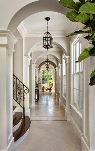 elegant foyer hallway with white wood panelling trim inlaid marble floors